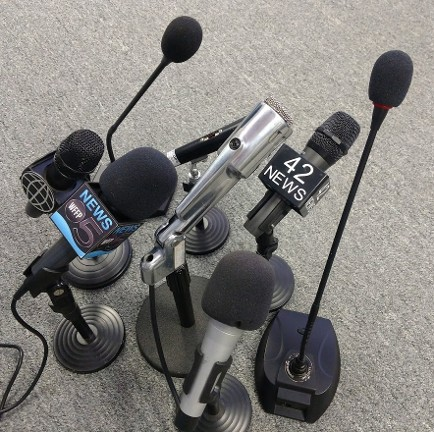 press conference  microphone groups