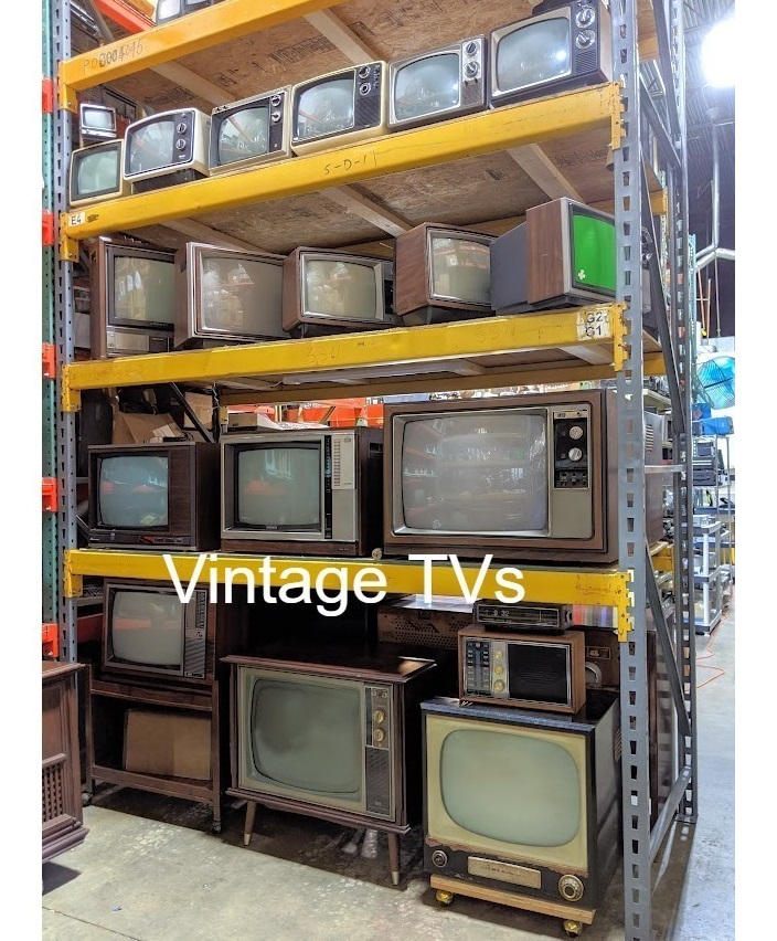 televisions on a rack props
